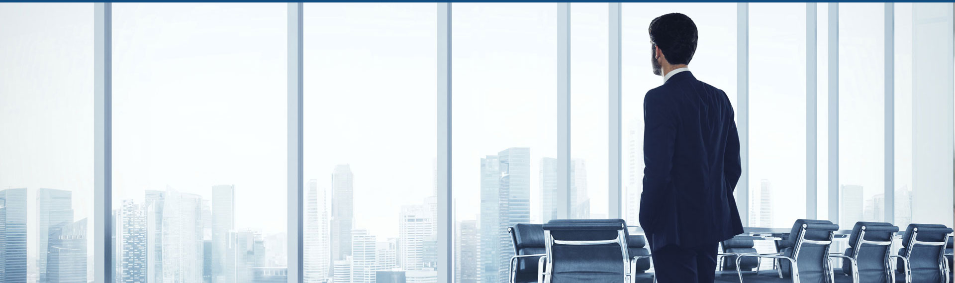 businessman-looking-window-900x267
